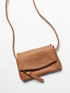Castle Crossbody | This super compact and distressed crossbody is deceivingly small, as it accordions out with multiple sections.  Zip and snap pockets with a magnetic closure and a long strap.   *By Free People