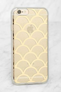 The Sonix Gold Lace iPhone 6 and 6s Case is dedicated to the one you love - your iPhone! This clear plastic case has a metallic gold scalloped lace print, plus shock-absorbent rubber sides, and access to all ports. Fits iPhone 6 and 6s.