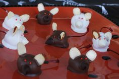 Chocolate (Or almond bark) Covered Spooky Mice! Start with STEM ON Maraschino Cherries. Drain them and dry them well with paper towels. Dip in almond bark, or chocolate bark. When they are semi dry, attach a chocolate chip for a nose, slivered almonds for ears, and little candies or sprinkles for eyes.