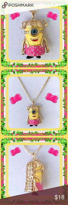 """🌺🌴🌺 PRETTY IN PINK MINION 🌺🌴🌺 🌺🌴🌺 This one eyed little girl pendant is adorable in her hot pink skirt all covered in crystal rhinestones.  Her one blue eye has fashionable goggles with more crystal rhinestones decorating the sides.  Both her arms and pig tails move.  She is a sweetheart that most little girls ( or big ) would love to have.  She is: 1 1/4"""" wide x 2 1/2"""" high.  Her depth:  1 1/4"""".  Chain:  rolled gold:  28"""" with a 2"""" extension. 🌺🌴🌺 Jewelry Necklaces"""
