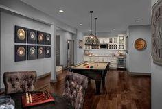 Traditional Game Room with Pendant Light, Hardwood floors, High ceiling, Columns, Built-in bookshelf