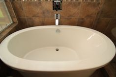 x The master bath of the Northwest Austin, TX home received a new free standing bath.