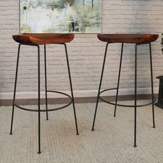 A scooped out solid mango wood seat offers a comfortable spot to sit on the Carolina Chair & Table Co. Granger 30 in. Bar Stool - Set of 2 . Decor, Furniture, Wood, Solid Mango Wood, Stool, Warm Wood, Bar Stools, Rustic Irons, Wood And Metal