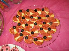 Ladybugs on Crackers w/ Pepperoni Wings and Black Olive Head (I would probably add a few pieces of chopped black olives for spots.)