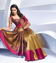 Silk sarees are indispensable to an Indian women's wardrobe. To match the grandiose of these sarees, one must carefully choose a designer blouse for an elevated look. Check out these gorgeous silk blouse designs to match different types of sarees. Sari Blouse, Silk Saree Blouse Designs, Saree Blouse Patterns, Bridal Sarees South Indian, Bridal Silk Saree, Indian Silk Sarees, Indian Bridal, Satin Saree, Silk Satin