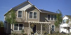 Duplex house plans narrow lot duplex design easily for Duplex plans that look like single family