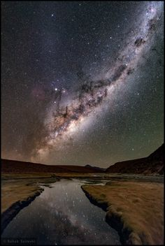NASA Astronomy Picture of the Day 2016 July 7 The Altiplano Night The Milky Way is massively bright on this cold, clear, altiplano night. At meters its reflection in a river, a volcanic peak on the distant horizon, is captured in this stitched. Cosmos, Astronomy Pictures, Galaxy Pictures, Space And Astronomy, Image Of The Day, Dark Skies, Galaxy Wallpaper, Milky Way, Science And Nature