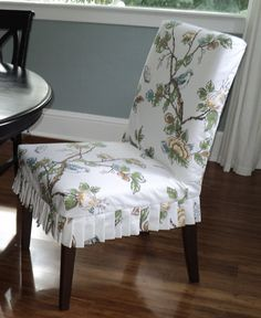 Via living in the Rain Garden Blog. Love this Ikea (yes, IKEA) side chair with the pretty slip cover with knife pleats