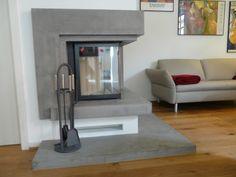 LifeBoXX - Beton Ciré Kaminverkleidung in Sichtbetonoptik, kombiniert mit einem sehr schönen 20 mm starken Holzdielenboden - Nov. 2011 - Ausführung: LifeBoXX S.Freund