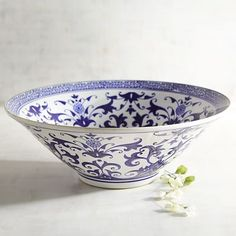 Intricately hand-painted in a traditional blue and white pattern, our decorative bowl will bestow a graceful touch to your entryway or dining table. Show off this beauty by itself, or create an instant centerpiece by adding a few Pier 1 decorative spheres. $80