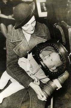 1939 English gas mask  mother and child