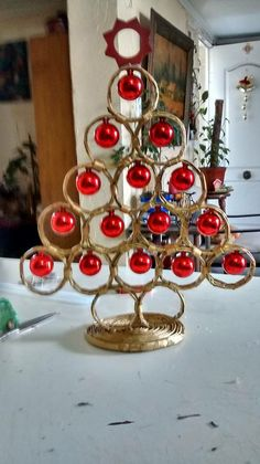 Newspaper rings glued painted gold or color if choice with glass ornaments