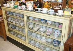 Found on EstateSales.NET: Nice old double side store display cabinet, cups & saucers and teapots.