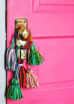 DIY Yarn Tassel Knob Bobbles: This tassel DIY is so adorable, but we think you can kick it up a notch by adding bells as a functional feature. Use them to keep track of your kids and family as they buzz in and out. (via Aunt Peaches)