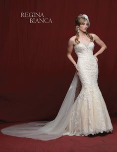 Regina Bianca  Style #RB1225  Elegant lace on tulle over satin sheath is strapless with a jeweled sweetheart neckline. There is a detachable tulle chapel train with lace accents.