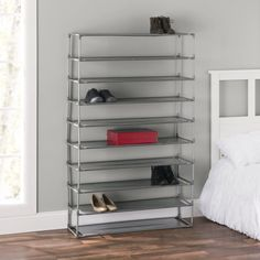 Keep the shoe clutter under control with this free-standing non-woven shoe shelf. This 10 layer shoe rack stores up to 50 pairs of shoes, making it the perfect rack to accommodate the expansive selection of shoes for the serious shoe aficionado to the large collection of footwear for a growing family. From delicate leather loafers to rugged rubber boots, each tier is crafted from breathable and durable non-woven material to provide a gentle yet sturdy foundation for all types of footwear. Comple Shoe Rack Store, 50 Pair Shoe Rack, Shoe Racks, Garage Shoe Rack, Garage Storage, Shoe Storage Cabinet, Bench With Shoe Storage, Storage Shelves, Storage Ideas