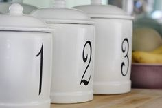 cute DIY idea - canisters are always at yard sales for cheap! fun!