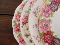 Beautifully paired set of 4 vintage salad plates. All are made of fine bone china, and have different floral patterns of pink and purple that are