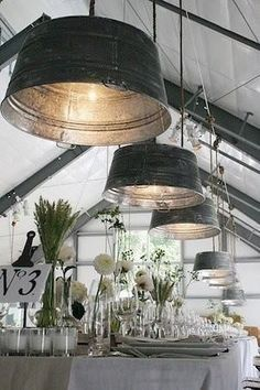 These washtubs turned lighting decor are so incredible. Perfect for a vintage Americana rustic wedding