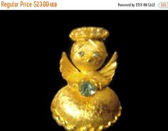 ❘❘❙❙❚❚ ON SALE ❚❚❙❙❘❘     Vintage guardian angel brushed gold metal brooch by Ultra, from the 1960s, this was called Angel on My Shoulder. Topaz blue colored stones, and a halo of clear stones. About an inch high and 3/4 inch wide. Excellent quality, and in very good vintage condition. To see more vintage jewelry:  https://www.etsy.com/shop/snapconclusions?ref=listing-shop2-all-items-count#items    ----------    About Shipping:    Items will be shipped within 1-2 business days after receipt…
