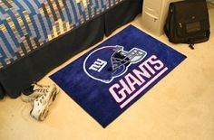 New York Giants Starter Rug 20x30  by Fanmats. $25.00. Decorate your home or office with area rugs by FANMATS. Made in U.S.A. 100% nylon carpet and non-skid recycled vinyl backing. Officially licensed and chromojet printed in true team colors. This item takes 7 to 10 business days to deliver.