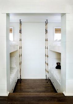Rope ladders add pirate fun to a kids' bunk room decked out all in white, via Remodelista