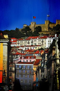 Castelo De Sao Jorgen by Mary Machare. The Castle of Sao Jorge (Castelo de Sao Jorge) is a Moorish castle occupying a commanding hilltop overlooking the historic centre of the Portuguese city of Lisbon and Tagus River.