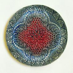 Wall art ceramic plate with mandala in red, blue and blue-green