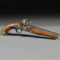 British Light Dragoon Pistol, c. 1810, walnut stock branded with P7A in front of the triggerguard, brass fittings, lockplate marked with a lion and a crown over 2, and dated 1810 on the tail, proof marks near breech of gun, lg. 16 in. Estimate $1,000-1,500