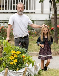 "Rick (Andrew Lincoln) with Judith in Carl's vision of a different, happy future | Season 8:Episode 9 - ""Honor"""