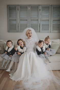 Great idea for a photo of the bride with her flower girls... on a couch with a simple clean background, have girls surround bride.  Love!