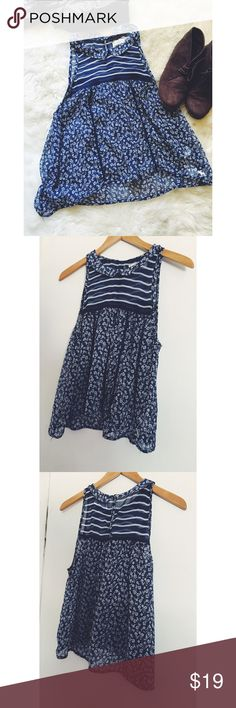 Abercrombie + Fitch Peter Pan Collar Swing Tank Adorable from top to bottom! This tank has a cute pater pan collar and a tiny floral print. Sheer material. Gently used. Great condition. Abercrombie & Fitch Tops Tank Tops