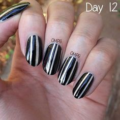 Silver stripes on black! Well, actually, I painted the silver first, then used striping tape to mark off the lines and then painted on black.. They're making my nails look longer..