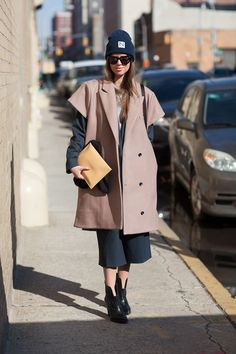Oversized coat to match oversized hat Under garments are simple colours Matches well with the coat