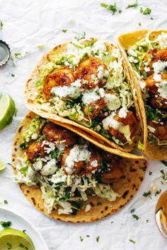 Shrimp Tacos with Garlic Cilantro Lime Slaw The best shrimp tacos! Spicy Shrimp Tacos with Garlic Cilantro Lime Slaw - ready in 30 minutes, loaded with flavor. SO YUM! Shrimp Recipes Easy, Slaw Recipes, Fish Recipes, Seafood Recipes, Gourmet Recipes, Mexican Food Recipes, Cooking Recipes, Healthy Recipes, Lasagna Recipes