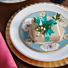 From tree to fireplace to dining room table, holiday cheer should be spread around every corner of the home! http://www.bhg.com/christmas/crafts/low-cost-christmas-projects/?socsrc=bhgpin121214presentplacesetting&page=7