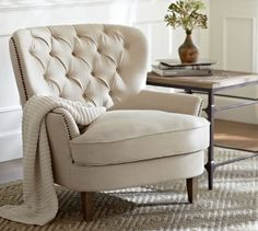 I saw this in the store and I'm OBSESSED with it, I want two for our Master Bedroom Cardiff Tufted Upholstered Armchair | Pottery Barn
