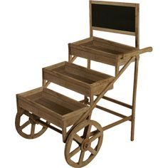 Display your prized impatiens and begonias in this farmhouse-inspired wood garden cart, featuring wheels and 3 shelves. Includes a top chalkboard panel.