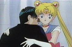 Sailor Moon holding Tuxedo Mask