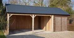 Two garages and a store for my gardening gear and kids toys. By The Stable Company.
