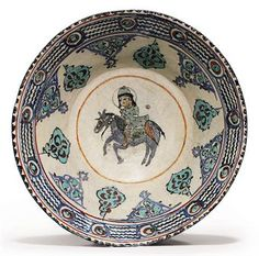 A MINAI POTTERY BOWL  SELJUK IRAN, LATE 12TH/EARLY 13TH CENTURY my father always told me that many centuries ago the Mongolians invaded Persia... I can so see that in this art work..