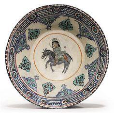 A MINAI POTTERY BOWL  SELJUK IRAN, LATE 12TH/EARLY 13TH CENTURY