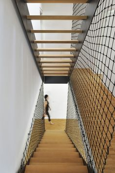 Spotted lately: ropes, netting, and tension wire cables as stairway enclosures and balustrades. Above: A safety balustrade made of net stretched from floor