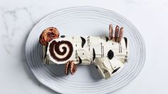The Buche de Noel, or Yule Log Cake, is a classic Christmas dessert. Soft sponge cake is rolled with a decadent cream filling, topped with frosting, and decorated to look like a yule log. The flavo. Meringue Mushrooms, Birch Branches, Egg Whisk, No Bake Cake, Bowl Set, Beautiful, Stuffed Mushrooms, Christmas Foods, Desserts