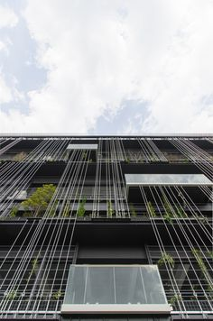Here we have undertaken a green wall project for a newly opened multi-storey car park in the coastal area of Nagoya, which has seen an increase in. Parking Building, Building Facade, Parking Lot, Building Design, Brick Architecture, Residential Architecture, Architecture Details, Facade Design, Exterior Design
