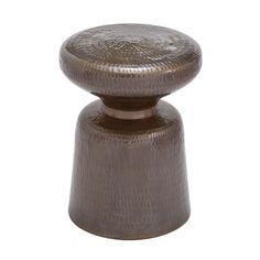 Hammered metal stool with a curving silhouette.  Product: StoolConstruction Material: MetalColor: