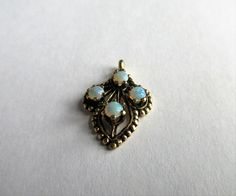 SOLD $39.00 Vintage 14K Yellow GOLD OPALS Pendant by feathersoup on Etsy