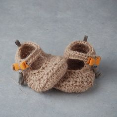 alpaca baby booties with leather bow and tassels