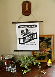 """These handmade chart wall hangings are made using genuine vintage Kentucky  bourbon labels blown up in black and white and mounted on strips of wood.  We have 3 bourbon styles available: Stonyridge, Southern Dew, and Old  Sport, with more coming soon! We also have one version with the full  """"Kentucky is My Land"""" poem print by Jesse Stuart. Perfect decor for a """"man  room"""" or bar!  handmade by Miss Molly Vintage  *will be rolled and shipped in a poster tube"""