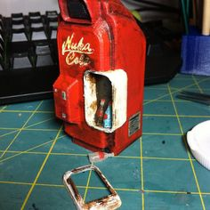 """Something we liked from Instagram! No heated workshop in winter means no woodwork unfortunately. In the mean time 3D printing painting. Miniature Fallout 4 Nuka Cola vending machine along with bottle of Nuka Cola """""""" Quantom and an empty. Still need to design and print the shelf then attach the door. Machine model from thingiverse made the bottle model original. #fallout4 #fallout #nukacola #nukacolaquantum #3dprinter #paint by lawson_woodwork check us out: http://bit.ly/1KyLetq"""